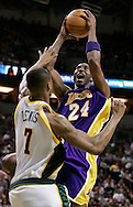 Los Angeles Lakers' Kobe Bryant shoots against Seattle SuperSonics' Rashard Lewis during the third quarter of their basketball game in Seattle. (AP Photo/John Froschauer)