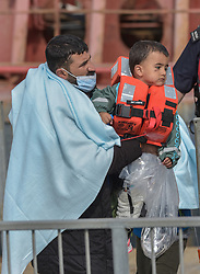 © Licensed to London News Pictures. 20/09/2021. Dover, UK.  Border Force officers assists migrants arriving at Dover Harbour in Kent. Migrants are continuing to attempt the crossing from France as the weather improves this week. Photo credit: Stuart Brock/LNP
