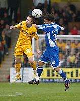 Photo: Steve Bond/Sportsbeat Images.<br />Torquay United v Exeter City. The FA Blue Square Premier. 01/01/2008. Diminutive Danny Stevens (L) wins the ball in the air against Wayne Carlisle (R)