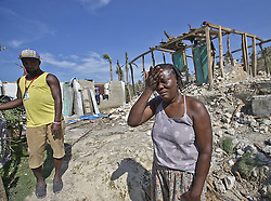 October 9, 2016 - HTI - Marie Louse Valentin 54, weeps in front of her shattered home in Morne la Source, Haiti on Sunday, Oct. 9, 2016. (Credit Image: © Patrick Farrell/TNS via ZUMA Wire)