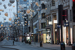 © Licensed to London News Pictures. 25/12/2016. Oxford St on Christmas Day. Christmas Day morning saw the West End of London's streets almost completely emptied of people. Credit : Rob Powell/LNP