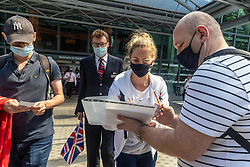 Licensed to London News Pictures. 09/08/202. London, UK. Olympic Gold medalist Laura Kenny arrives at London Heathrow Terminal 5 from Tokyo this afternoon as Team GB celebrate 22 gold medals in one of the most successful Olympics on record. Jason and Laura Kenny became Britain's most successful Olympic athletes with Jason clinching his 7th gold and Laura winning her 5th gold including a gold and silver at the Tokyo games. Photo credit: Alex Lentati/LNP