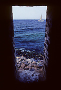"Île de Gorée, ""Gorée Island"", Slave House, thedoor utilised to embark the slaves on the ships. Gorèe is a small island near Dakar famous as a slave trade center.The island is a UNESCO World Heritage Site."