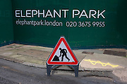 A Man at Work sign at Elephant Park, as new development at Elephant & Castle, on 4th January, London borough of Southwark, England.