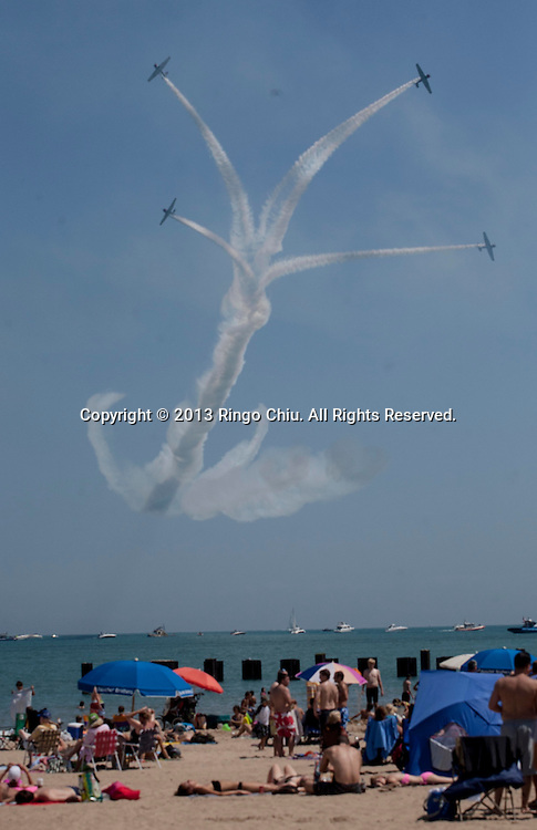 The U.S. Navy Blue Angeles practice for the Air and Water Show on Friday, August 16, 2013 in Chicago, Illinois.  (Photo by Ringo Chiu/PHOTOFORMULA.com)