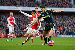 George Friend of Middlesbrough is challenged by Alexis Sanchez of Arsenal - Photo mandatory by-line: Rogan Thomson/JMP - 07966 386802 - 15/02/2015 - SPORT - FOOTBALL - London, England - Emirates Stadium - Arsenal v Middlesbrough - FA Cup Fifth Round Proper.