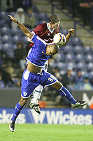 Photo: Pete Lorence/Sportsbeat Images.<br />Leicester City v Burnley. Coca Cola Championship. 10/11/2007.<br />Collins John clears the ball from Chris McCann.