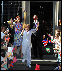 The Prime Minister David Cameron and his wife Samantha wave of Florence Rowe in Downing St, as she heads of to the next leg of the Olympic torch relay on the eve of the Olympic games, Thursday July 26, 2012. Photo by Andrew Parsons/i-Images.All Rights Reserved ©Andrew Parsons.See Instructions