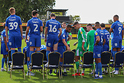 AFC Wimbledon setting up for the photo shoot during the official team photocall for AFC Wimbledon at the Cherry Red Records Stadium, Kingston, England on 8 August 2019.