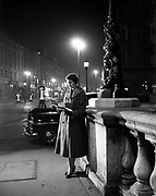 27/03/1956<br /> 03/27/1956<br /> 27 March 1956<br /> Woman on O'Connell Bridge at night. Special for Irish Architect and Contractor.