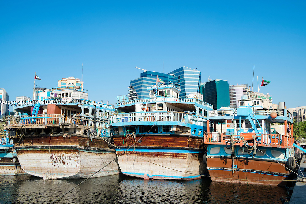 Traditional cargo dhows at cargo wharf on The Creek in Dubai United Arab Emirates
