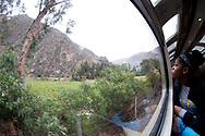 Kalaezia Collins, 13, looks out unto the Andes Mountains as she enjoys the three hour ride on the Vistadome train.