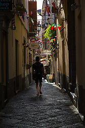 Sorrento, Italy, September 16 2017. A man walks down one of the narrow, shady, cobbled streets in Sorrento, Italy. © Paul Davey