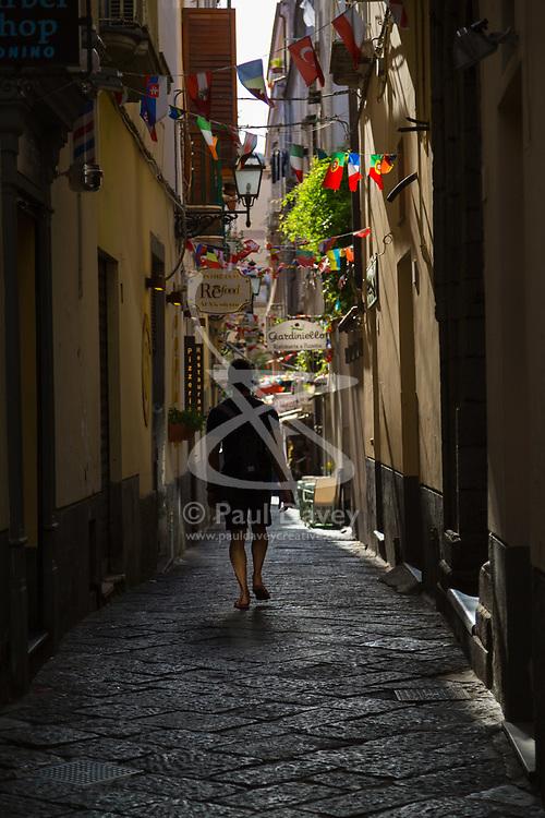 Sorrento, Italy, September 16 2017. A man walks down one of the narrow, shady, cobbled streets in Sorrento, Italy. © Paul Davey