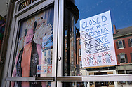 A sign on the front door of 2nd Base Vintage in Easton, Pennsylvania delivers a message to potential customers Mar. 21, 2020, as communities across the Lehigh Valley are adjusting to life during the coronavirus pandemic that is impacting the daily lives of Pennsylvania residents both socially and economically. (Photo by Matt Smith)