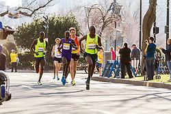 Boston Marathon: BAA 5K road race, lead men turn onto Commonwealth Avenue, Philip Langat, Daniel Salel, Ben True, Stephen Sambu