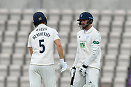 Joe Weatherley of Hampshire and James Vince of Hampshire talk between overs during the first day of the Specsavers County Champ Div 1 match between Hampshire County Cricket Club and Essex County Cricket Club at the Ageas Bowl, Southampton, United Kingdom on 5 April 2019.