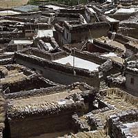 Marpha village, Kali Gandaki Valley, Nepal. Sheaves of graindrying on the roofs of houses.