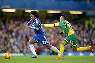 Willian of Chelsea breaks past Nathan Redmond of Norwich City . Barclays Premier league match, Chelsea v Norwich city at Stamford Bridge in London on Saturday 21st November 2015.<br /> pic by John Patrick Fletcher, Andrew Orchard sports photography.