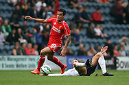 Liverpool's Philippe Coutinho goes past Preston North End's Neil Kilkenny. pre-season friendly match, Preston North End v Liverpool at Deepdale in Preston, England on Saturday 19th July 2014.<br /> pic by Chris Stading, Andrew Orchard sports photography.
