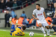 Tottenham Hotspur midfielder Mousa Dembele clashes with Juventus forward Paulo Dybala during the Champions League match between Tottenham Hotspur and Juventus FC at Wembley Stadium, London, England on 7 March 2018. Picture by Toyin Oshodi.