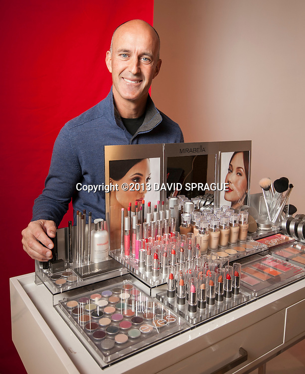 John Maly, owner of Mirabella Beauty poses with a line of his products. The Valencia-based company is expanding into Europe.  Shot Feb. 20th,  2013 Photo by David Sprague ©2013