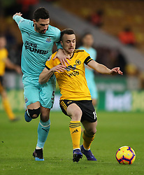 Newcastle United's Fabian Schar and Wolverhampton Wanderers' Diogo Jota (right) battle for the ball during the Premier League match at Molineux, Wolverhampton.