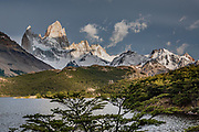 """Mount Fitz Roy (3405 m or 11,171 ft elevation) seen from Laguna Capri, Los Glaciares National Park, El Chalten, in Santa Cruz Province, Argentina, Patagonia, South America. Monte Fitz Roy is also known as Cerro Chaltén, Cerro Fitz Roy, or Mount Fitz Roy. The first Europeans recorded as seeing Cerro Fitz Roy were the Spanish explorer Antonio de Viedma and his companions, who in 1783 reached the shores of Viedma Lake. In 1877, Argentine explorer Francisco Moreno saw the mountain and named it Fitz Roy in honour of Robert FitzRoy who, as captain of HMS Beagle, had travelled up the Santa Cruz River in 1834 and charted large parts of the Patagonian coast. Mt Fitz Roy was first climbed in 1952. Cerro is a Spanish word meaning hill, while Chaltén comes from a Tehuelche word meaning """"smoking mountain"""", due to clouds that usually form around the peak.  Los Glaciares National Park and Reserve are honored on UNESCO's World Heritage List."""