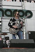 Manchester, TN, June 12, 2005; Caleb Followill and Matthew Followill of Kings of Leon performs during The Bonnaroo 2005 Arts and Music Festival. Mandatory Credit: Photo by Bryan Rinnert