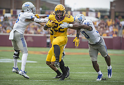 September 16, 2017 - Minneapolis, MN, USA - Minnesota running back Kobe McCrary (22) scores on a 1-yard touchdown run between Middle Tennessee cornerback Mike Minter, left, and linebacker Darius Harris during the second quarter at TCF Bank Stadium, Saturday, Sept. 16, 2017, in Minneapolis. The host Gophers won, 34-3. (Credit Image: © Elizabeth Flores/TNS via ZUMA Wire)