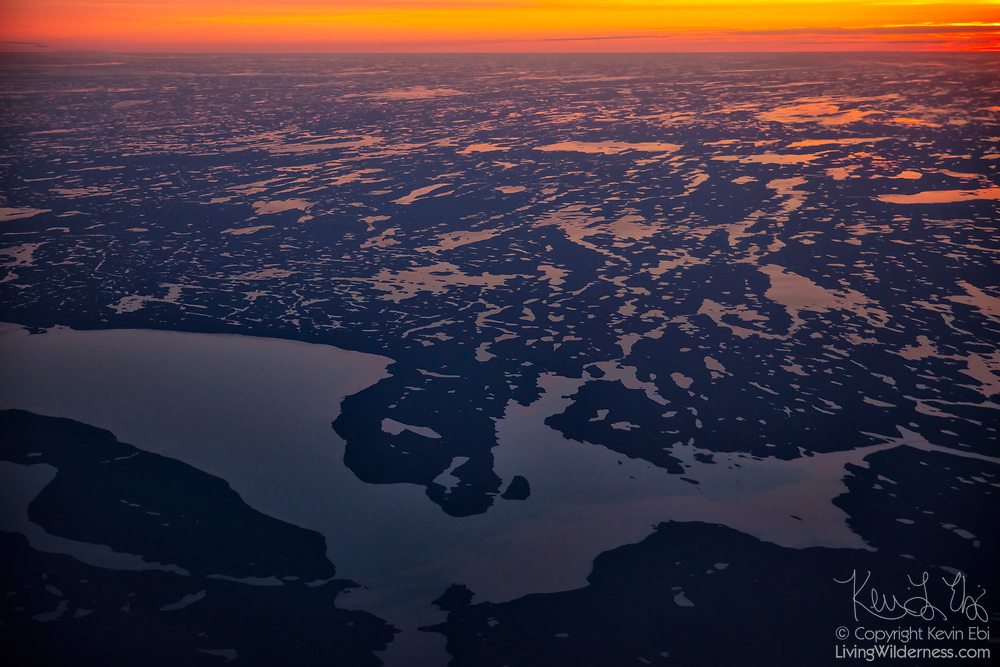 The large Schultz Lake and thousands of others are visible in the golden light of dusk in this aerial view over Nunavut, Canada. The lakes are in the Kivalliq Region (also spelled Keewatin). The Thelon River carries water into and out of Schultz Lake.