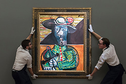 © Licensed to London News Pictures. 22/02/2018. LONDON, UK. Technicians present ''Le Matador'' by Pablo Picasso, (Est. £14,000,000 - 18,000,000) at the preview of Sotheby's upcoming Impressionist, Modern & Surrealist Art auctions taking place at Sotheby's, New Bond Street, on 28 February. Photo credit: Stephen Chung/LNP