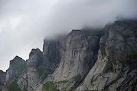 Storm clouds cover mountain peaks, Lofoten islands, Norway