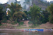 Boat trip up to the Thousand Buddha Caves on the Mekong River, Luang Prabang, Laos..