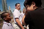 NEW YORK, NY – MAY 25, 2011: Isaiah Brown, Sergio Alvarez and Alex Rodriguez surround twenty year-old Basilio Bonilla on a field trip to New York City. Bonilla is a volunteer with the Donegan Elemntary School and a candidate for the Bethlehem Area School Board.<br />