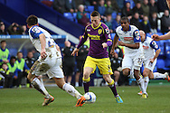 Notts County's Callum McGregor (c) looks to go past Tranmere Rovers' Liam Ridehalgh. Skybet football league one match, Tranmere Rovers v Notts county at Prenton Park in Birkenhead, England on Saturday 15th March 2014.<br /> pic by Chris Stading, Andrew Orchard sports photography.