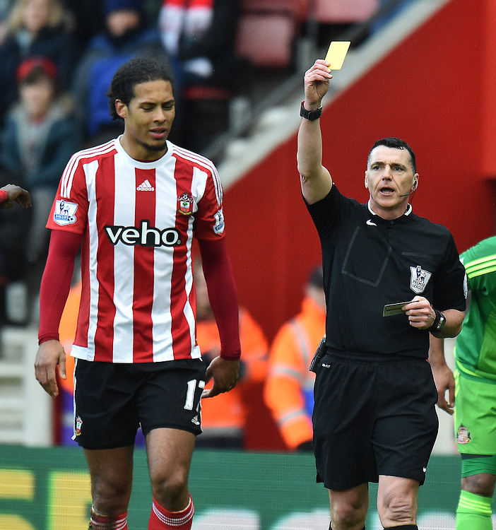 Southampton's Virgil van Dijk gets a Yellow card for a foul on Sunderland'a Dame N'Doye<br /> <br /> Southampton 1 - 1 Sunderland<br /> <br /> Photographer David Horton/CameraSport<br /> <br /> Football - Barclays Premiership - Southampton v Sunderland - Saturday 5th March 2016 - St Mary's Stadium - Southampton<br /> <br /> © CameraSport - 43 Linden Ave. Countesthorpe. Leicester. England. LE8 5PG - Tel: +44 (0) 116 277 4147 - admin@camerasport.com - www.camerasport.com