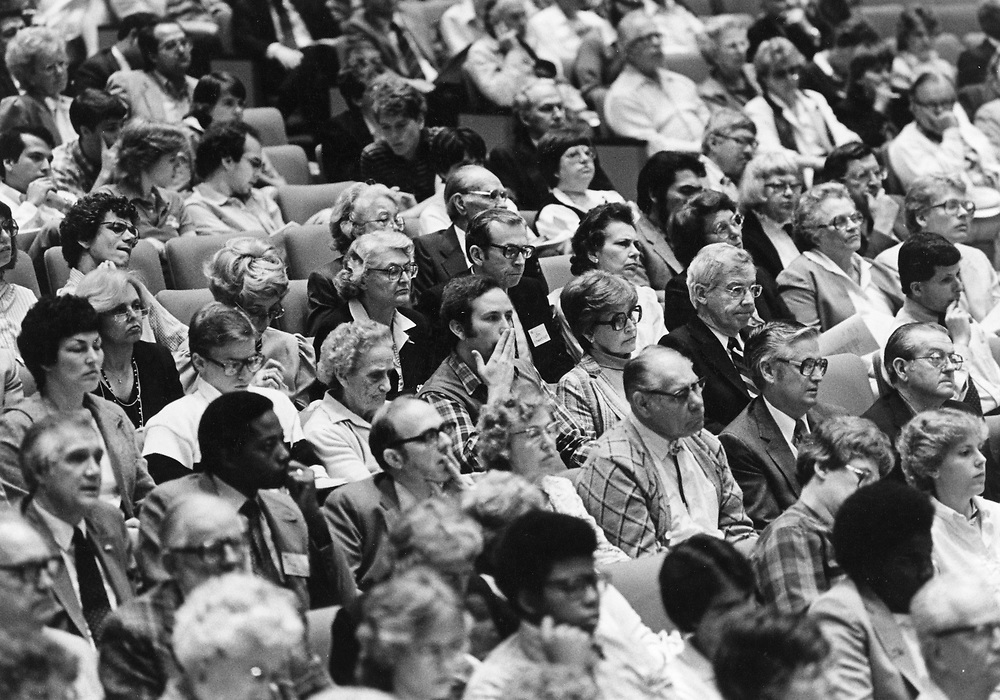 ©1989 crowd at public hearing on transportation issues, Austin, Texas.