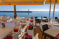 Restaurant overlooking harbour entrance, Puerto Banus, Malaga Province, Spain, uncrowded, off-season, December, 2018, 201812100145<br /> <br /> Copyright Image from Victor Patterson, Belfast, UK, BT9 5HG<br /> <br /> t: +44 28 9066 1296 (from Rep of Ireland 048 9066 1296)<br /> m: +44 7802 353836<br /> <br /> victorpattersonbelfast@gmail.com<br /> www.victorpatterson.com<br /> <br /> Please see my Terms and Conditions of Use at https://www.victorpatterson.com/page2<br /> It is IMPORTANT that you familiarise yourself with them.<br /> <br /> Images used on the Internet incur an additional cost and must be visibly watermarked i.e. © Victor Patterson within the body of the image and copyright metadata must not be deleted. Images used on the Internet have a size restriction of 4kbs and are chargeable at rates available at victorpatterson.com.<br /> <br /> This image is only available for the use of the download recipient i.e. television station, newspaper, magazine, book publisher, etc, and must not be passed on to any third party. It is also downloaded on condition that each and every usage is notified within 7 days to victorpattersonbelfast@gmail.com.<br /> <br /> The right of Victor Patterson to be identified as the author is asserted in accordance with The Copyright Designs And Patents Act (1988). All moral rights are asserted.