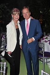 ROSEMARY SAID and HUGO SWIRE at a dinner hosted by Cartier in celebration of the Chelsea Flower Show held at Battersea Power Station, 188 Kirtling Street, London SW8 on 23rd May 2011.