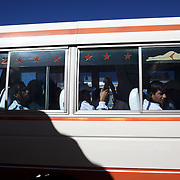 'Attitude at Altitude' Football in Potosi, Bolivia'..The Real Potosi team arrive by mini bus for the match between Real Potosi and Wilstermann at the The Estadio Victor Agustin Ugarte, Potosi, Bolivia, Real Potosi won the match 3-0. 2nd May 2010. Photo Tim Clayton..'Attitude at Altitude' Football in Potosi, Bolivia'..The Calvario players greet the final whistle with joyous celebration, high fives and bear hugs the players are sprayed with local Potosina beer after a monumental 3-1 victory over arch rivals Galpes S.C. in the Liga Deportiva San Cristobal. The Cup Final, high in the hills over Potosi. Bolivia, is a scene familiar to many small local football leagues around the world, only this time the game isn't played on grass but a rock hard earth pitch amongst gravel and boulders and white lines that are as straight as a witches nose, The hard surface resembles the earth from Cerro Rico the huge mountain that overlooks the town. .. Sitting at 4,090M (13,420 Feet) above sea level the small mining community of Potosi, Bolivia is one of the highest cities in the world by elevation and sits 'sky high' in the hills of the land locked nation. ..Overlooking the city is the infamous mountain, Cerro Rico (rich mountain), a mountain conceived to be made of silver ore. It was the major supplier of silver for the spanish empire and has been mined since 1546, according to records 45,000 tons of pure silver were mined from Cerro Rico between 1556 and 1783, 9000 tons of which went to the Spanish Monarchy. The mountain produced fabulous wealth and became one of the largest and wealthiest cities in Latin America. The Extraordinary riches of Potosi were featured in Maguel de Cervantes famous novel 'Don Quixote'. One theory holds that the mint mark of Potosi, the letters PTSI superimposed on one another is the origin of the dollar sign...Today mainly zinc, lead, tin and small quantities of silver are extracted from the mine by over 100 co operatives and private mining companies who s