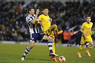 West Brom's Gareth McAuley (l) tackles Dwight Gayle of Crystal Palace. FA Cup with Budweiser, 3rd round, West Bromwich Albion v Crystal Palace match at the Hawthorns in Birmingham, England on Saturday 4th Jan 2014.<br /> pic by Andrew Orchard, Andrew Orchard sports photography.