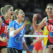 Vakifbank GS TT's  Maja POLJAK (L) and Gizem GURESEN (C), Jelena NIKOLIC (R) celebrate victory during their Women's Volleyball CEV Champions League semi final match at Burhan Felek Arena in Istanbul, Turkey on 20 March 2011. Photo by TURKPIX