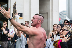 London, UK. 9th June, 2018. Supporters of Tommy Robinson, former leader of the far-right English Defence League, taunt anti-fascists protesting against the March for Tommy Robinson outside Downing Street.