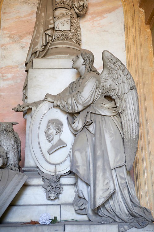 Picture and image of a classical style stone angel sculpture by sculptor  Santo Varni (Genoa, 1807 – 1885), The monumental tombs of the Staglieno Monumental Cemetery, Genoa, Italy .<br /> <br /> Visit our ITALY PHOTO COLLECTION for more   photos of Italy to download or buy as prints https://funkystock.photoshelter.com/gallery-collection/2b-Pictures-Images-of-Italy-Photos-of-Italian-Historic-Landmark-Sites/C0000qxA2zGFjd_k<br /> If you prefer to buy from our ALAMY PHOTO LIBRARY  Collection visit : https://www.alamy.com/portfolio/paul-williams-funkystock/camposanto-di-staglieno-cemetery-genoa.html