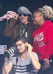 © Licensed to London News Pictures. 24/06/2017. Actor JOHNNY DEPP watches Run The Jewels playing on the Pyramid Stage at the 2017 Glastonbury festival. Photo credit: Jason Bryant/LNP