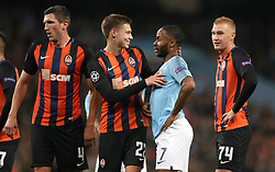 Shakhtar Donetsk's Mykola Matviyenko (centre) talks to Manchester City's Raheem Sterling (second right) after the penalty is awarded