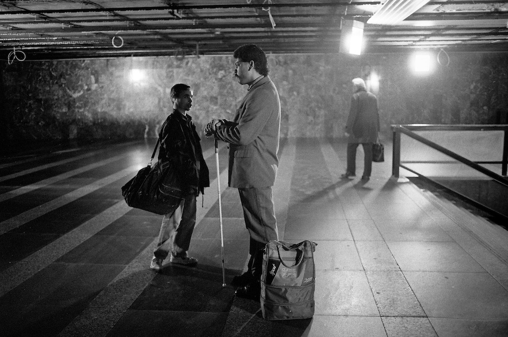 """Mario Bihari at the subway station """"Florenc"""" in Prague. Mario is a well known blind Roma musician originally from Slovakia living since he finished his studies in Prague, Czech Republic. Beside being a very talented multi-instrumentalist working as a professional musician he is also experimenting with photography as a another way to express himself. The image is dated around 1996 when we were corperating for the first time in a photography project."""