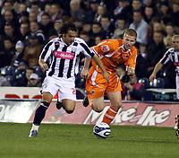 Photo: Mark Stephenson.<br /> West Bromwich Albion v Blackpool. Coca Cola Championship. 23/10/2007.West Brom's Filipe Teixeira (L) wins the ball