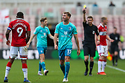 AFC Bournemouth defender Jack Stacey (17) is shown a yellow card by the referee Matthew Donohue during the EFL Sky Bet Championship match between Middlesbrough and Bournemouth at the Riverside Stadium, Middlesbrough, England on 19 September 2020.